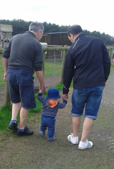 Grandad and Daddy walking with Leyton