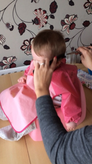 Having her first haircut