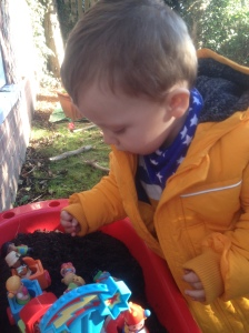 Nathan at one of his toddler classes, playing in compost